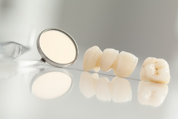 Loose teeth sitting next to dental equipment